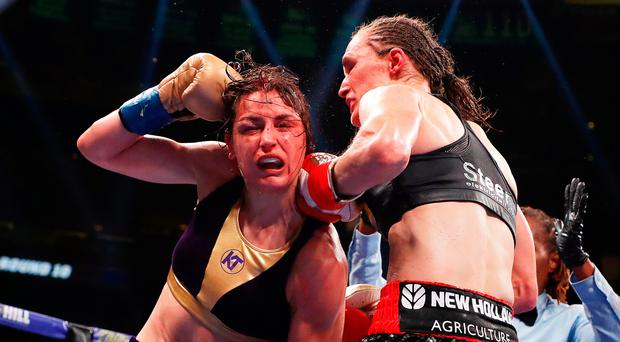 Tough night: Katie Taylor feels the full force of Delfine Persoon