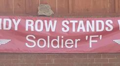 Sandy Row stands with Soldier F banner
