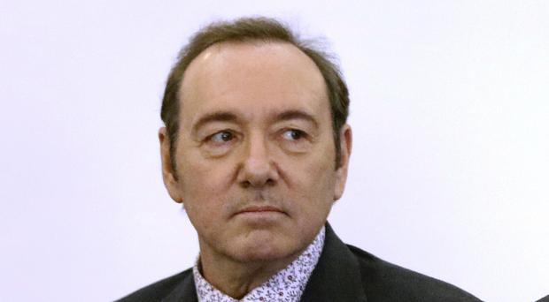 Kevin Spacey stands in district court (Nicole Harnishfeger/The Inquirer and Mirror/AP)