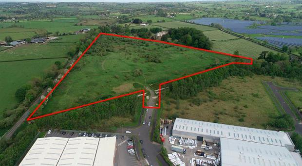 The triangle of land next to Knockmore Industrial Estate