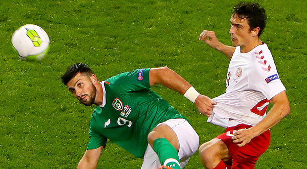 War of words: Republic's Shane Long with Thomas Delaney, who has been critical of the Irish