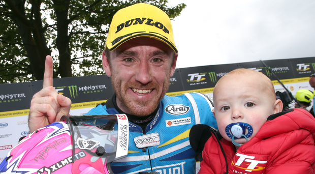 Nice one son: Lee Johnston celebrates his first TT victory with his little boy Jessie