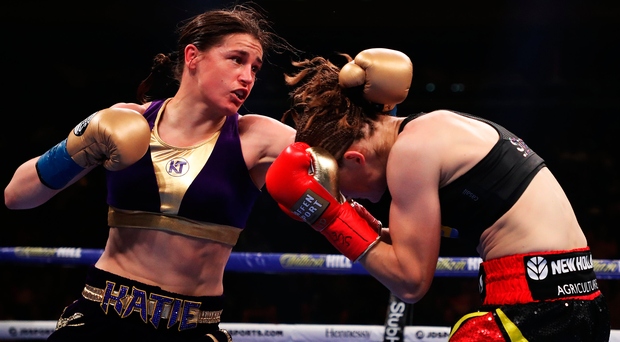 Close quarters: Katie Taylor and Delfine Persoon exchange punches during their lightweight unification fight