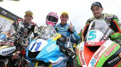 Lee Johnston celebrates his first TT win in Monday's Supersport race today with runner-up James Hillier and third placed Peter Hickman.