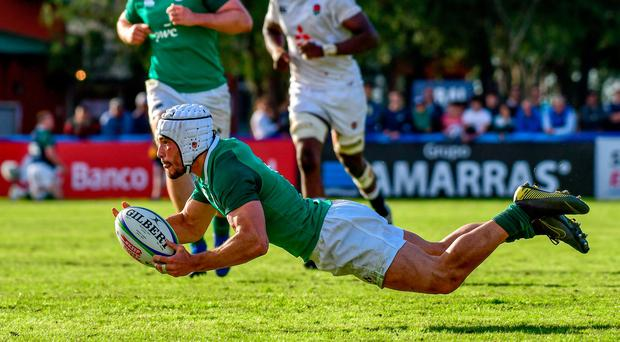 Iwan Hughes of Ireland jumps with the ball during a first round match between England U20 and Ireland U20 as part of World Rugby U20 Championship 2019 at Club de Rugby Ateneo Inmaculada on June 4, 2019 in Santa Fe, Argentina. (Photo by Amilcar Orfali/Getty Images)