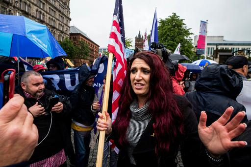 Jayda Fransen former deputy leader of Britain First stages a corner protest with supporters at a