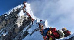 A queue of climbers wait to get to the summit of Everest last month