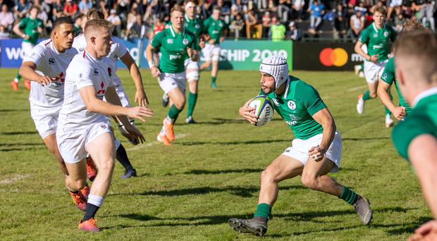 Front foot: Ulster's Iwan Hughes runs at the England defence in yesterday's World Championship match