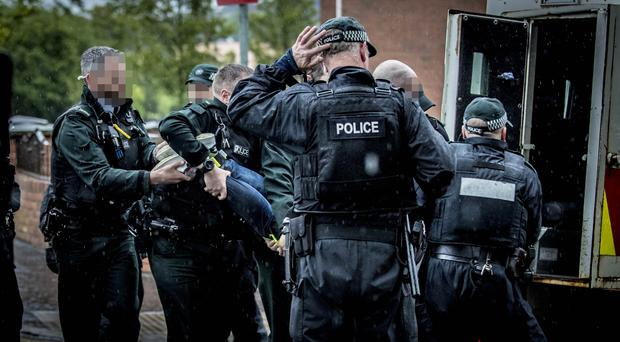Police officers make two arrests at La Salle Drive on the Falls road in west Belfast on June 4th 2019 (Photo by Kevin Scott for Belfast Telegraph)