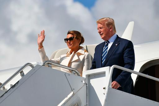 US President Donald Trump (R) and First Lady Melania Trump (L) disembark Air Force One upon arrival at Shannon Airport in Shannon, County Clare, Ireland on June 5, 2019. (Photo by MANDEL NGAN / AFP)MANDEL NGAN/AFP/Getty Images