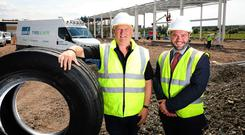 Norman Kerr, managing director at Kerr's Tyres and Auto, and Ryan Mawhinney, senior relationship manager of commercial banking NI at Ulster Bank