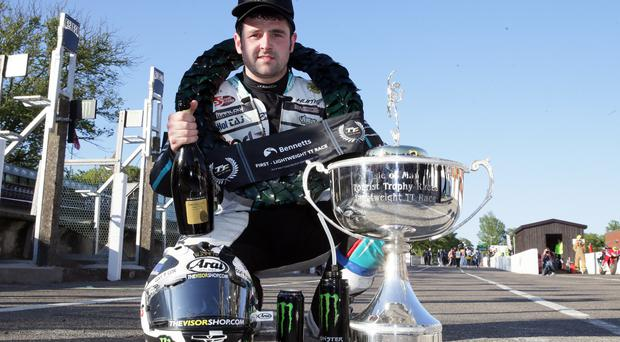 Michael Dunlop celebrates winning the Lightweight TT on the (Reparto Corse Paton). It was his 19th TT win and the 50th TT win for the Dunlop family. Pic: Stephen Davison