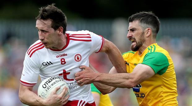 No quarter: Tyrone's Colm Cavanagh and Paddy McGrath of Donegal in last year's All-Ireland quarter-final clash