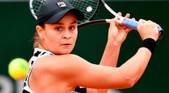 Focused: Ashleigh Barty powers to victory over Amanda Anisimova yesterday to book a place in today's decider