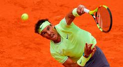 Powerhouse: Rafael Nadal blasts his way to victory over Roger Federer in Paris yesterday