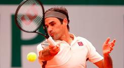 Battler: Roger Federer on his way to defeat yesterday