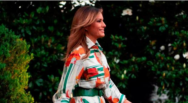 Melania's Gucci shirt dress, with red buses