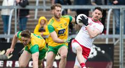Tyrone's Matthew Donnelly and Donegal's Stephen McMenamin and Hugh McFadden Mandatory Credit ©INPHO/Evan Logan