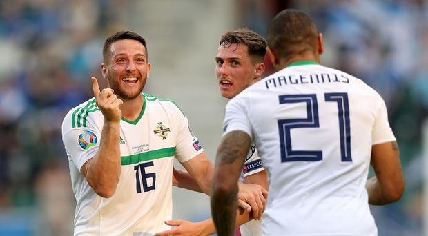 Conor Washington and Josh Magennis are both claiming Northern Ireland's equalising goal in Tallinn.