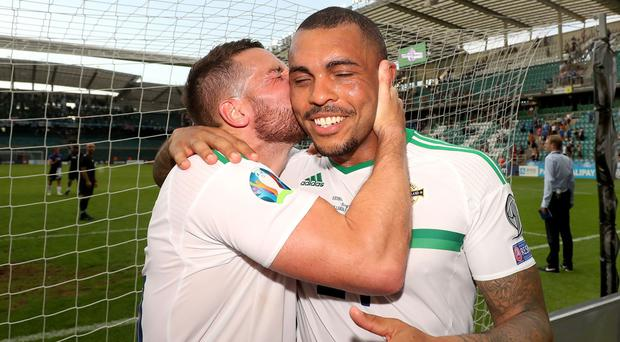 Conor Washington gives Josh Magennis a kiss after their decisive impact off the bench.
