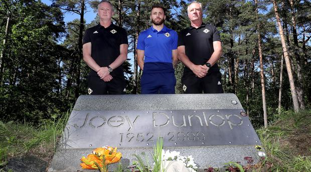 Northern Ireland manager Michael O'Neill, assistant manager Jimmy Nicholl and midfielder Stuart Dallas at the memoria. Credit: William Cherry/Presseye