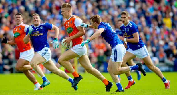 Cavan's Jason McLoughlin with Rian O'Neill of Armagh. Credit: INPHO/Tommy Dickson