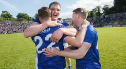 Cavan's Oisin Pierson celebrates after the win over Armagh with Gearoid McKiernann and Jack Brady. Credit: INPHO/Tommy Dickson