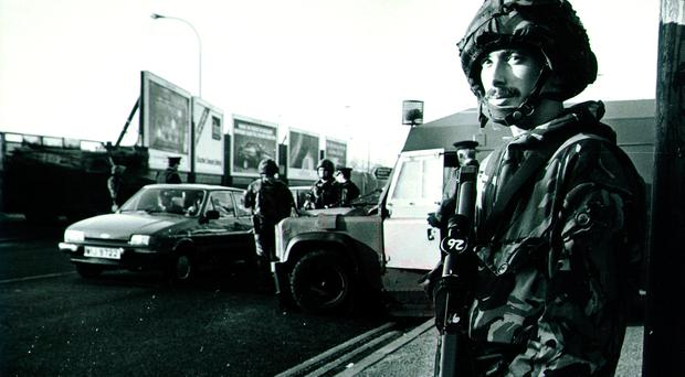 Soldiers and the RUC manning a checkpoint in Belfast in 1990