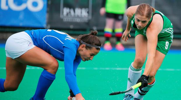 Closed down: Captain Katie Mullan battles for Ireland yesterday