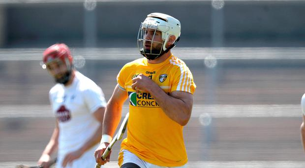 Making point: Antrim ace Neil McManus hit 13 points in vain