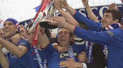 Fernando Ricksen lifts the SPL Trophy during his time at Rangers.