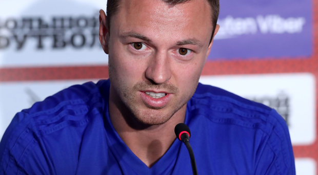 Bring it: Jonny Evans has 12 points out of 12 in his sight