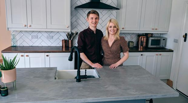 Michael Holmes and Laura Dixon in their new kitchen
