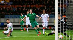 Northern Ireland's Paddy McNair slams home the late winner to edge out Belarus.