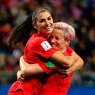 Demolition job: Alex Morgan (left) of the USA celebrates with team-mate Megan Rapinoe after scoring her team's 12th goal
