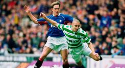 Committed: Fernando Ricksen challenges Celtic's Henrik Larsson