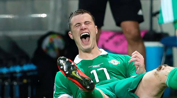 Air we go: Paddy McNair celebrates his winner in Belarus last night