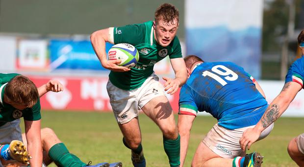 Full speed: Ireland's Colm Reilly makes a break