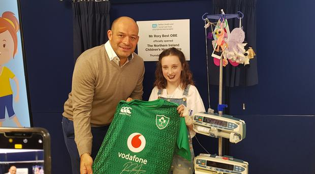 Ulster rugby player Rory Best and Aimee Brady (aged 10) at the opening of the new heart centre at Royal Victoria Hospital in Belfast.