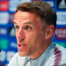 Quizzed: Phil Neville faces the media in Le Havre yesterday