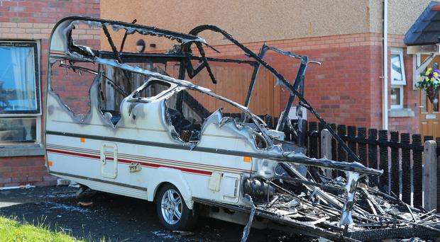 Police at the scene of an arson attack in the Lagmore Avenue area of west Belfast on June 14th 2019 (Photo by Kevin Scott for Belfast Telegraph)