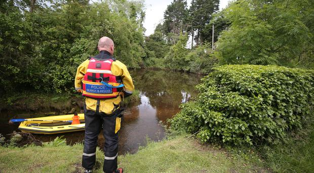 Underwater searches are conducted by a specialist team in Castle Espie Wetlands area outside Comber in Co. Down. Photo by Jonathan Porter / Press Eye .