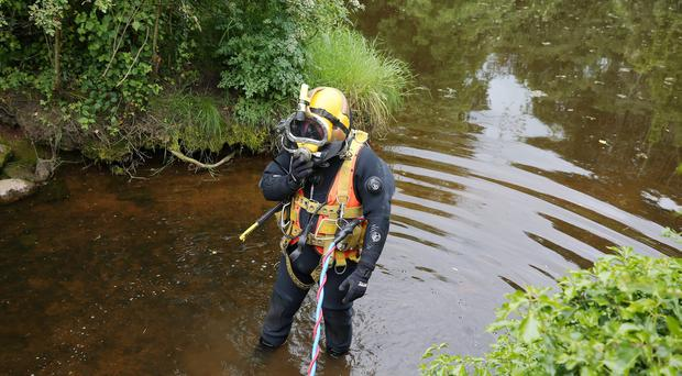 Press Eye - Belfast - Northern Ireland - 14th June 2019 Underwater searches are conducted by a specialist team in Castle Espie Wetlands area outside Comber in Co. Down. Police continue the search or 55-year-old Pat McCormick as part of their murder investigation. Mr McCormick was last seen in the Comber area on May 30. Photo by Jonathan Porter / Press Eye .