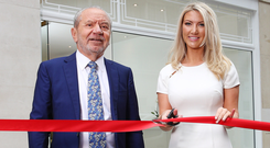 Dr Leah Totton cuts the ribbon at her new clinic with Lord Sugar