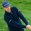 On target: Justin Rose plays from a bunker at the 17th hole yesterday at Pebble Beach