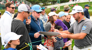 In demand: Graeme McDowell signs autographs for fans this week