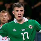 Killer touch: Paddy McNair slots in the late winner for Northern Ireland against Belarus