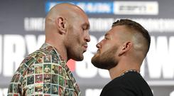 Face to face: Tyson Fury and his opponent Tom Schwarz