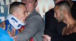 Tension: Josh Warrington and Kid Galahad at the weigh-in