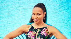 In bloom: Valerie Morris-Campbell wearing a JD Williams Floral Magiscult High Neck Swimsuit, £28